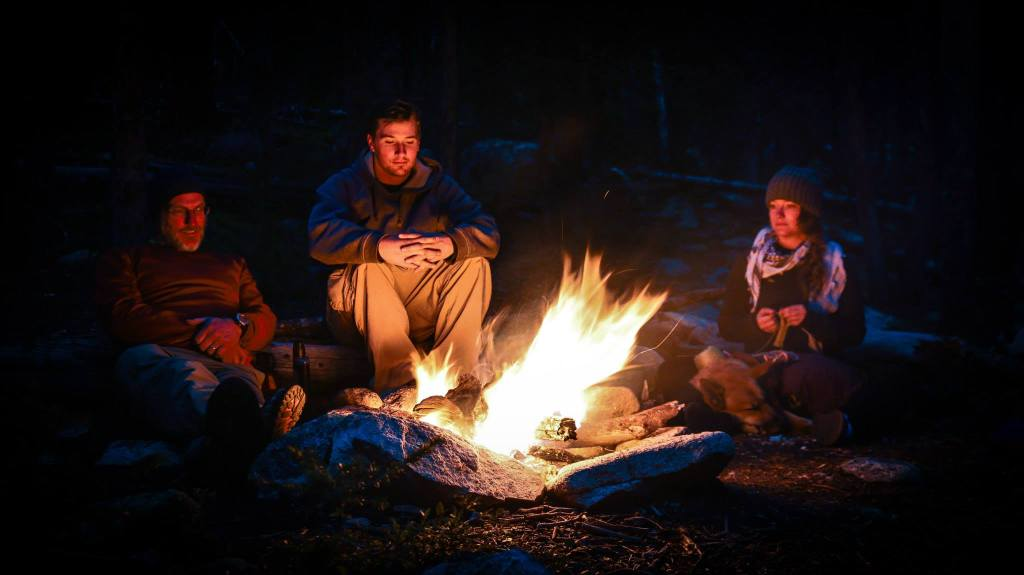 family backpacking campfire