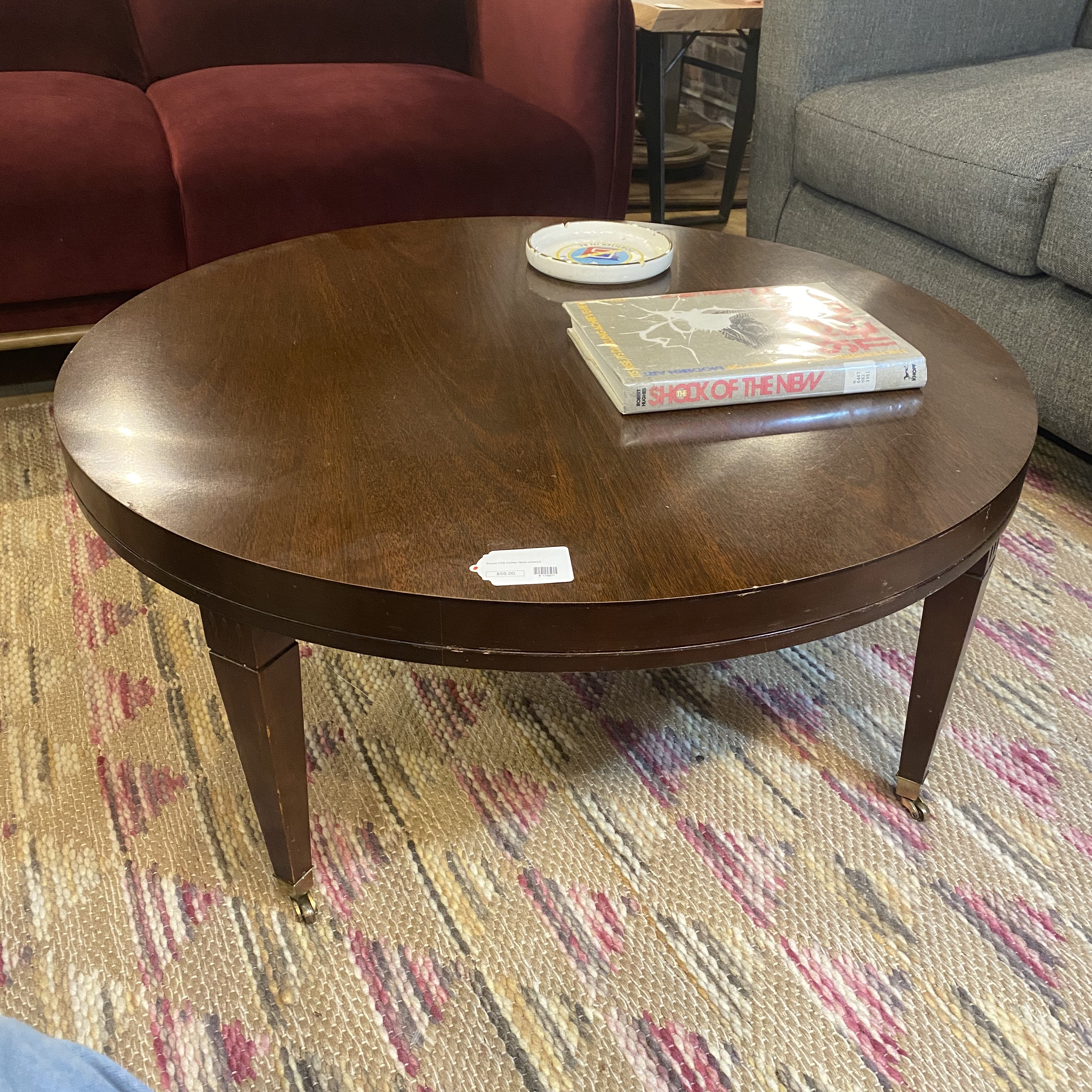 round vintage coffee table w casters sold
