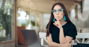 Woman With Finger on the Lips Looking at Laptop catfish