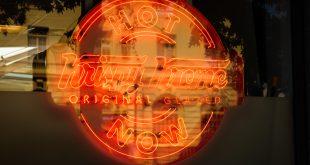 Krispy Kreme Sign With Building Reflection