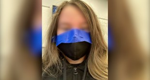 Student with mask taped to face.
