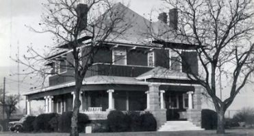 Walker - Wilde Home: This home built by druggist/banker E.D. Walker in 1906, is located at 301 N. 13th Street. The upper transom windows originally held stained glass. The home has Ionic columns joined by a crisp looking balustrade, beautiful stone columns on each side of the entry steps, and long brackets over the second level roof overhang. The home is now owned by Mr. and Mrs. Daniel Wilde.