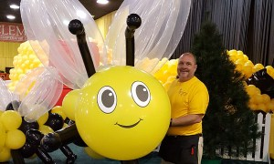 Shawn with giant balloon bee, by Balloonopolis, Columbia, SC