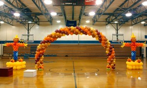 Fall themed balloon arch and scarecrows, by Balloonopolis, Columbia, SC
