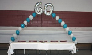 String-of-Pearls helium balloon arch using Megaloons, by Balloonopolis