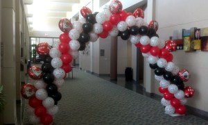 Casino themed balloon arch, by Balloonopolis