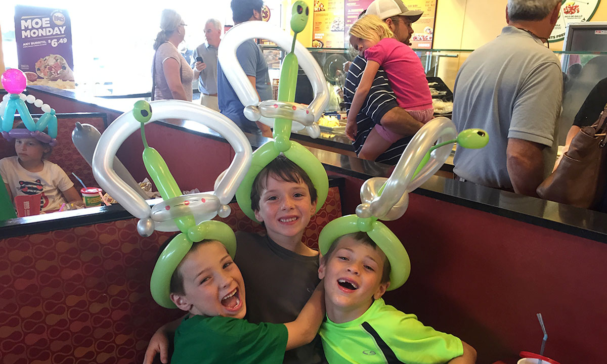 Kids wearing crazy balloon hats at Moe's Restaurant, by Balloonopolis, Columbia, SC