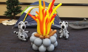 Balloon raccoons around a fire, by Balloonopolis, Columbia, SC