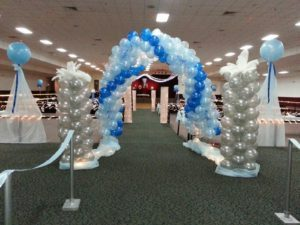 Blue and white balloon arch by Cathy's Creations