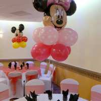 Mickey Mouse and Minnie Mouse balloon centerpieces and arch