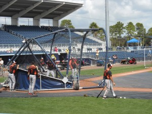Members of the Baltimore Orioles warm up during a 2012 Spring Training game with the Tampa Bay Rays. Photo R. Anderson