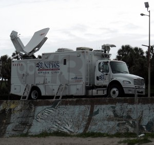 The television news vans have been all gassed up but so far have not had any storms to chase during the 2013 Atlantic Hurricane Season. This has led to some news stations to complain about the lack of storms. Photo R. Anderson