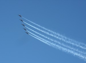 Flyovers such as this one by the United States Navy's Blue Angels are perfectly good at sporting events. Players wearing camouflage, not so much. Photo R. Anderson