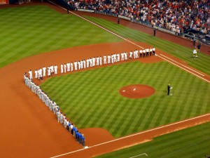 One of the highlights of opening night is when the players from both teams are introduced and line the infield before the game. Photo R. Anderson