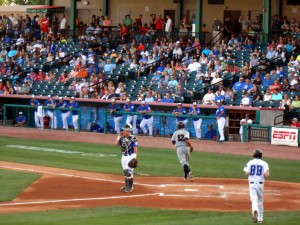 Former Houston Astro turned Somerset Patriots shortstop Edwin Maysonet  (#12) collects his bat after rounding the bases on a foul pole rattling home run given up by Tracy McGrady Saturday night as Koby Clemens and the Skeeters dugout look on. Photo R. Anderson