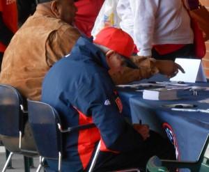 Milo Hamilton signs an autograph during the 2014 Astros Fan Fest. Photo R. Anderson