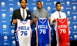 Philadelphia 76ers NBA draft picks Jahlil Okafor, left, Richaun Holmes, center, and J.P. Tokoto hold up jerseys during a press conference at the 76ers practice facility, Saturday, June 27, 2015, in Philadelphia. (AP Photo/Michael Perez) ORG XMIT: PAMP108