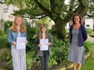 Dr Rainey Principal Ballyclare High School congratulates Leah McDonald and Ellen Spence on their achievement of 4 A grades at AS level.