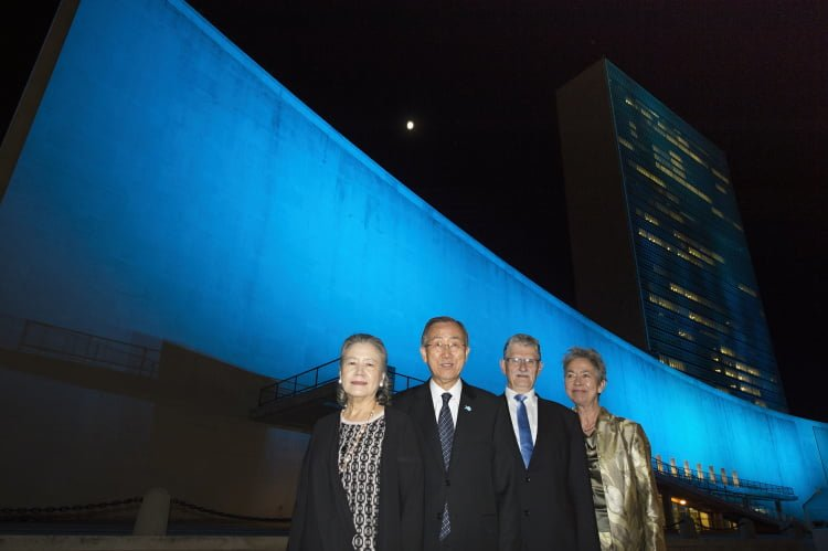 To mark the 70th anniversary of the founding of the United Nations, and UN Day on October 24, UNHeadquarters in York City was lit up in blue for two nights, namely, on October 23 when the UN concert was held, and on October 24, UN Day. Pictured in front of UN Headquarters, is UN Secretary-General Ban Ki-moon with his wife,Yoo Soon-taek (first from left), together with Mogens Lykketoft, second from right, Danish President of the 70th session of the UN General Assembly, with his wife, Mette Holm, on October 23. UN Photo/Eskinder Debebe.