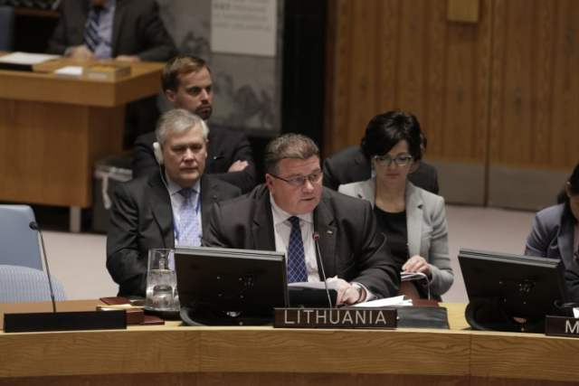 """Linas Antanas Linkevičius, Minister for Foreign Affairs of the Republic of Lithuania, is shown addressing a December 11 UN Security Council meeting on the situation in Ukraine at UN Headquarters in New York. As the Foreign Minister stated, """"the continuing conflict in Ukraine cannot be allowed to fester or be forgotten just because we are facing the pressing need to address other urgent challenges."""" UN Photo/Evan Schneider."""