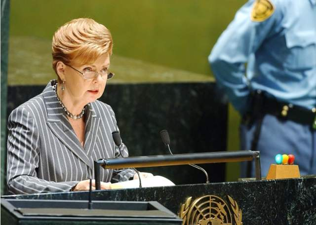 "Shown here is former Latvian President, Vaira Vike-Freiberga, addressing the fifty seventh session of the UN General Assembly at United Nations Headquarters in New York on September 12, 2002. Vaira Vike- Freiberga, is pictured in the ""NO HOME TO GO TO"" exhibit, in the section on the Restoration of Independence. UN Photo/Mchelle Poire."