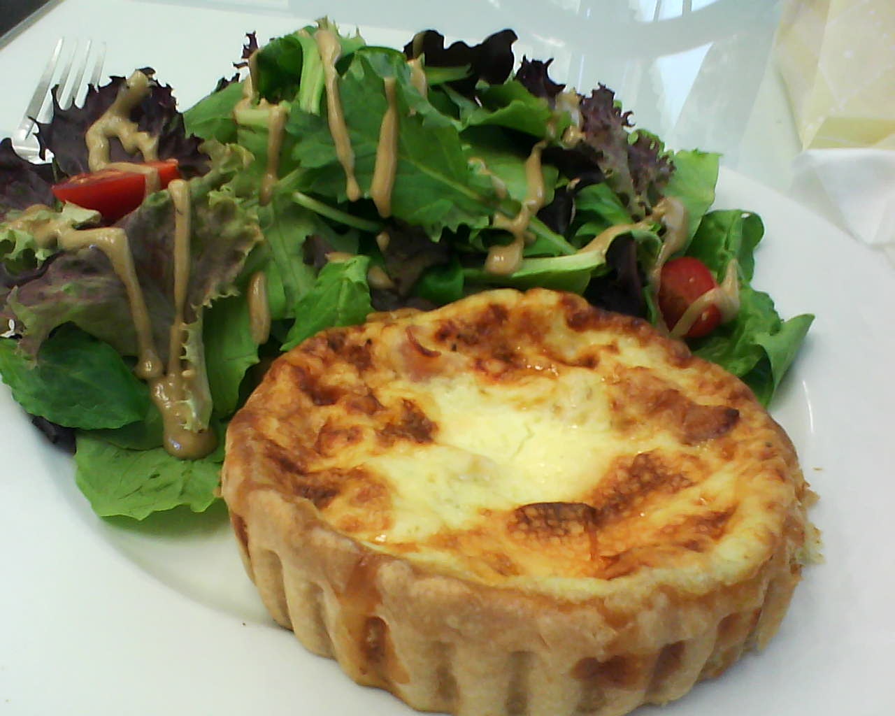 Pillowy perfect Quiche Lorraine and greens with a Dijon vinaegrette at Le Patissier.