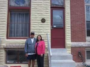 Roland Moskal with Lisa Doyle in front of 3408 Fait Avenue.