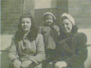 Barbara Baynes (middle) with her family on the steps at 643 South Kenwood Avenue.