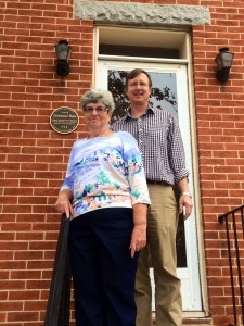 Ms. Jane Buccheri in front of her Centennial Home at 840 W. Pratt St. with Baltimore Heritage Director Johns Hopkins.