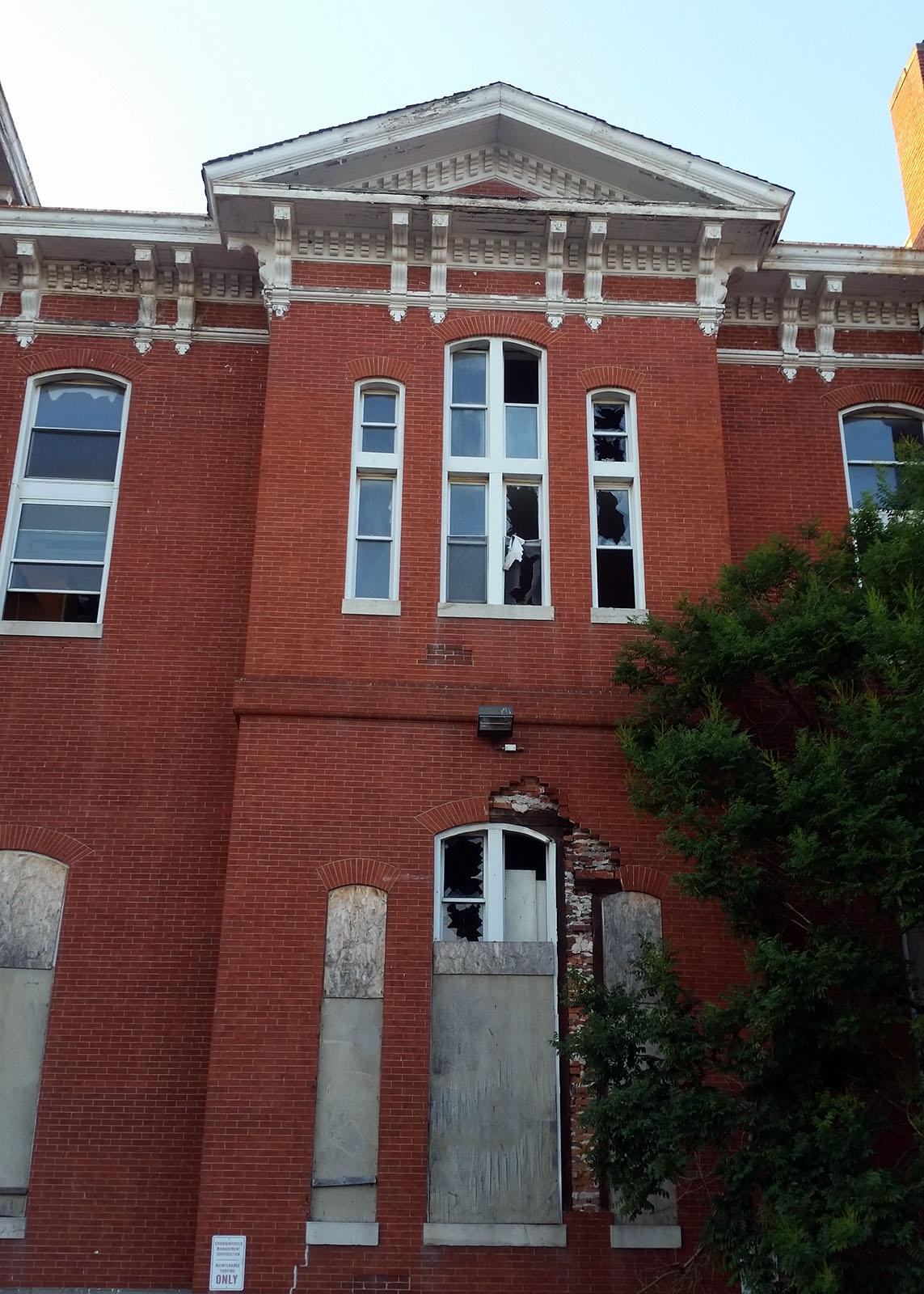 Damaged windows, Eastern Female High School. Photograph by Johns Hopkins, 2015 July 11.