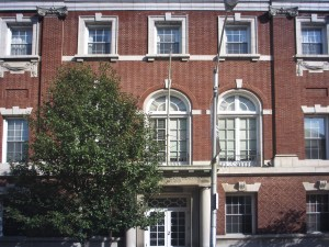 A close view of a three-story brick building.