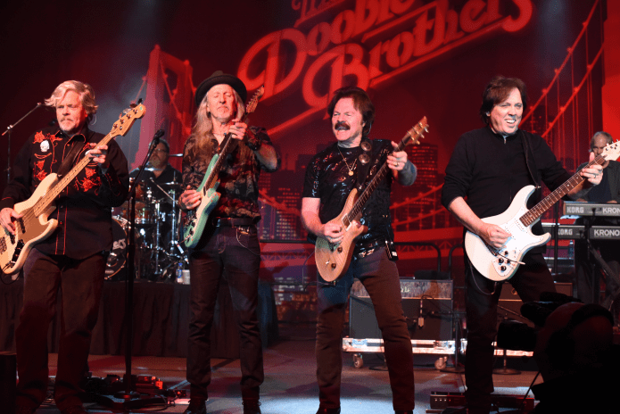 Tom Johnston of The Doobie Brothers invites  Nestor to listen to the Hall of Fame music