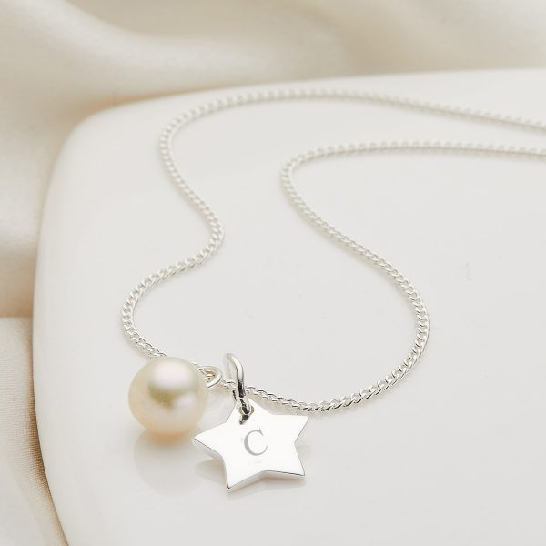 My First Pearl Star Necklace, £42, Molly Brown London.