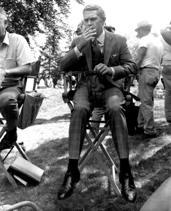 McQueen takes a smoke break during production in Cambridge Cemetery.