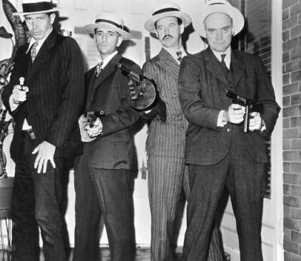The Dillinger Gang: Dillinger, Van Meter, Pierpont, and Makley. Is Dillinger wearing jeans here, or am I crazy?