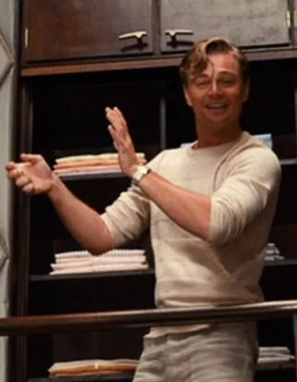 A very jovial Leonardo DiCaprio as Jay Gatsby in The Great Gatsby (2013).