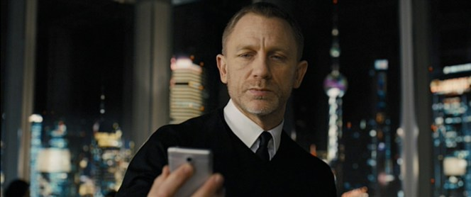 Bond takes a quick break from secret agenting to check his Facebook.