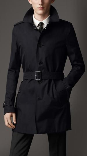 A modern navy blue Burberry trench coat, likely the very item Bond would wear if Fleming was writing about him today. Note that the model is wearing a very Bondian white shirt and black tie.