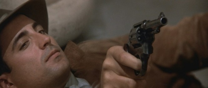 Stone aims his Smith & Wesson.