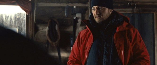Cross layers his jackets for a cold trek through Alaska.