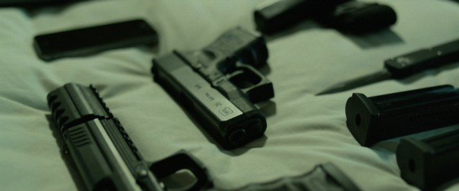 One of John Wick's Glocks. This also gives us a nice shot of the P30L's custom compensator.