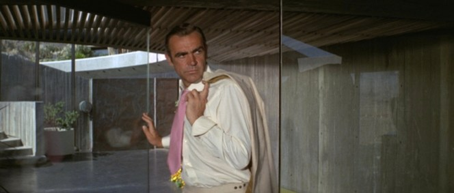 Connery is mystified: why did he need to wear a suit and tie if he was just going to take off the jacket for most of the scene anyway?