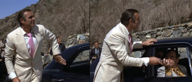 The buttoned jacket keeps the tie in place. Unfortunately, Bond gets a bit overzealous about the buttoning.