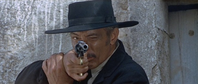 """When Lee Van Cleef is aiming a .45-caliber revolver with a 10"""" barrel, this isn't the side you want to be looking at."""