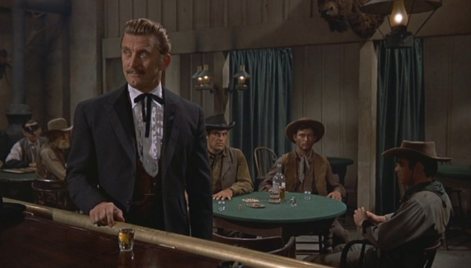A terse Lee Van Cleef eyes up Doc from his drinking table.