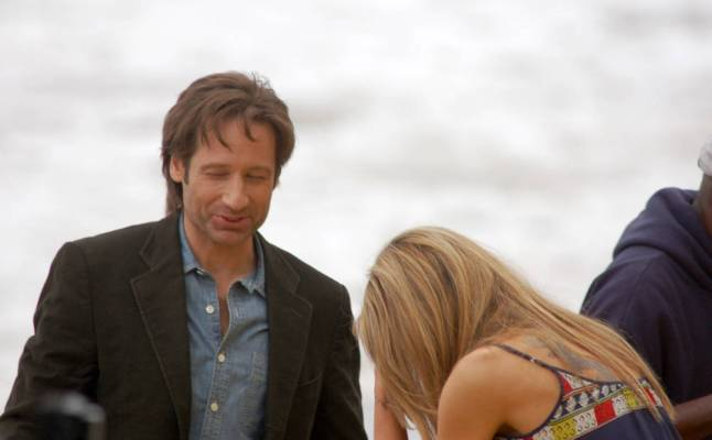 A behind-the-scenes shot of Dave and Natascha filming on the beach.