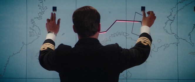 Bond's digital SEIKO is seen as he proves the British nuclear submarine plans are on the world market.
