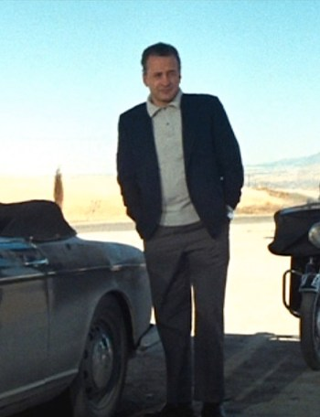 Harry Garmes proudly stands beside his BMW.