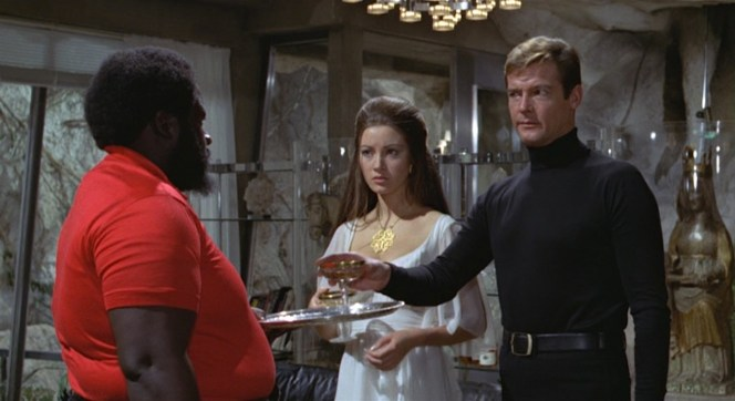 Bond judges Whispers and Kananga's crew for wearing the strangest henchmen uniforms yet: red polos with tight jeans.