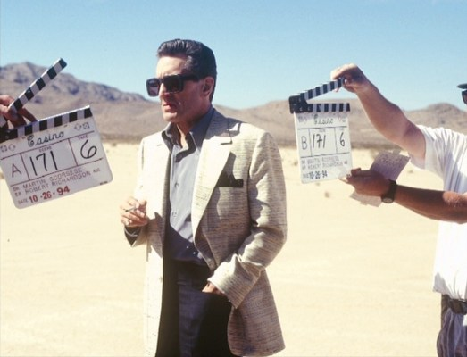 A behind-the-scenes shot of De Niro on location, filming in the desert on October 26, 1994 (according to the clapperboards).